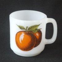オレンジ柄のマグカップ