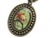 お花と自転車のオーバルネックレス  Ellene(スペイン)